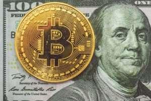 Bitcoin on hundred dollars bills